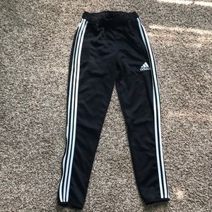 Adidas joggers with triple stripes down side.